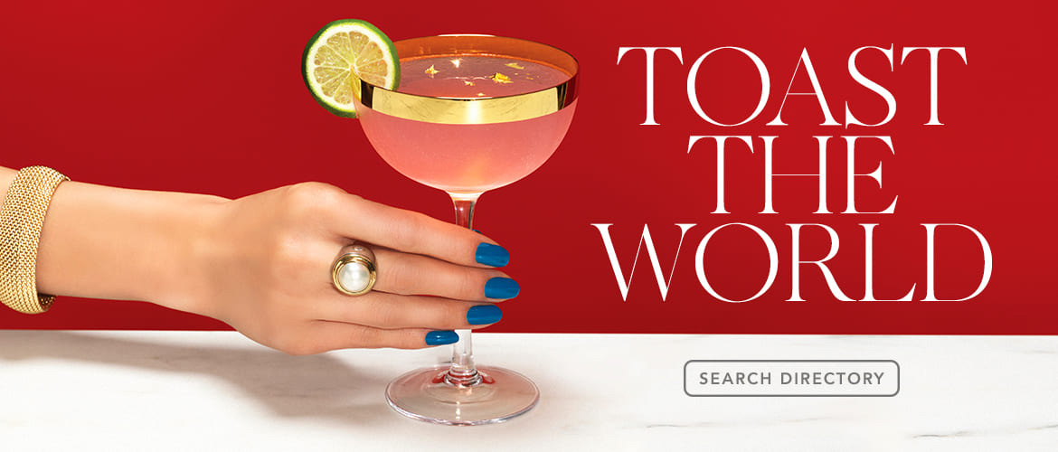 toast to the world text with hand of woman holding martini glass