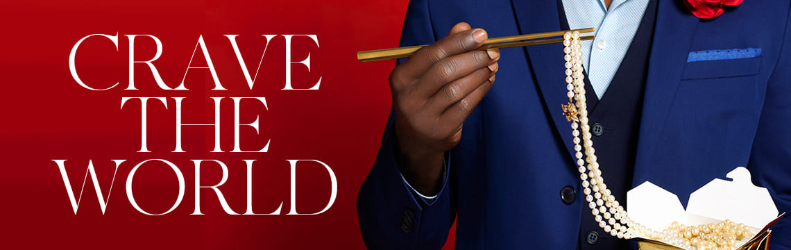 crave the world text with man holding a chop stick with pearls dangling