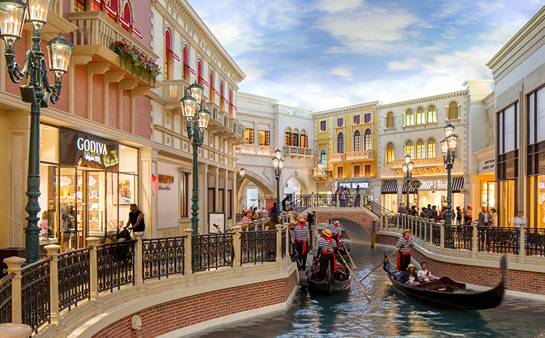 Venetian-styled Grand Canal Shoppes features an indoor canal where shoppers can ride in gondolas.